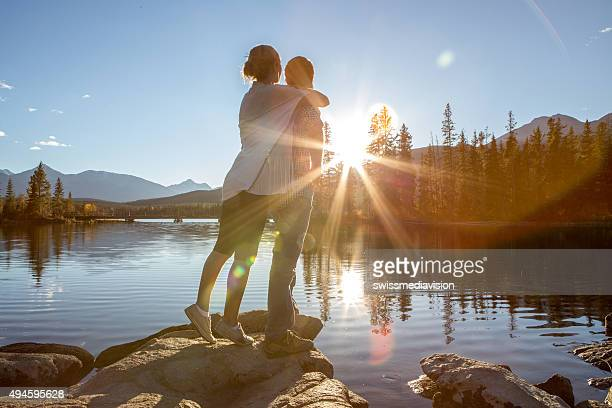 Young couple affectionate by the lake