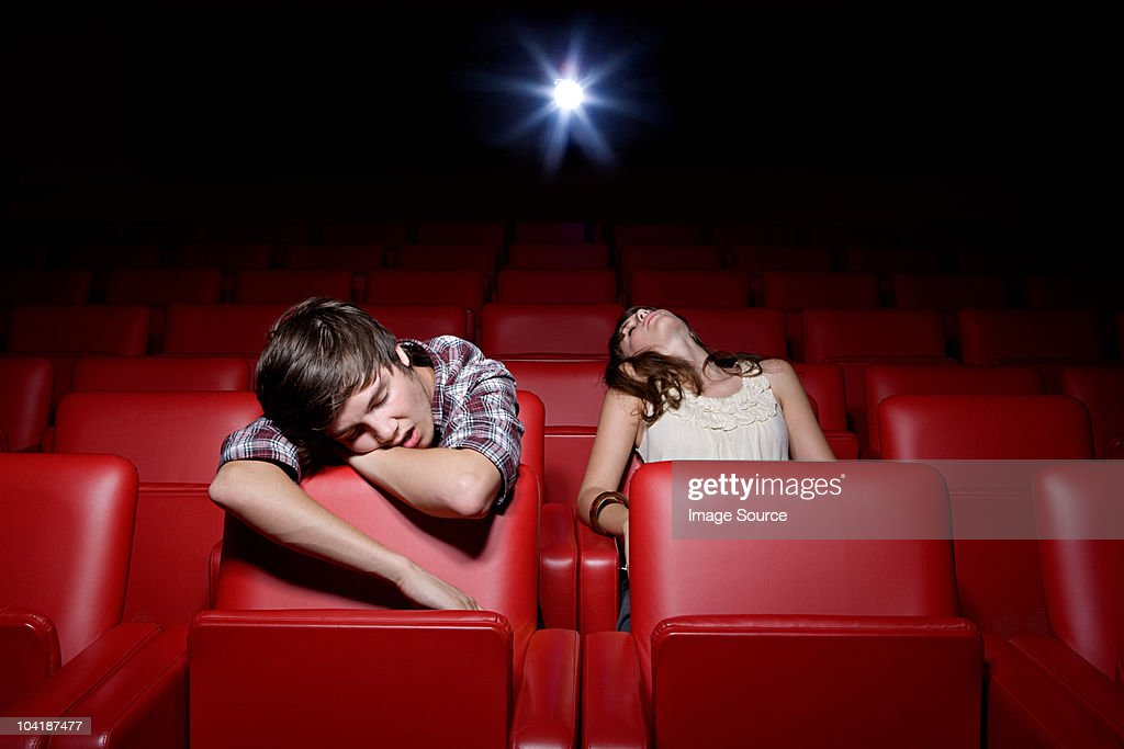 Young couple asleep in the movie theater : Stock Photo