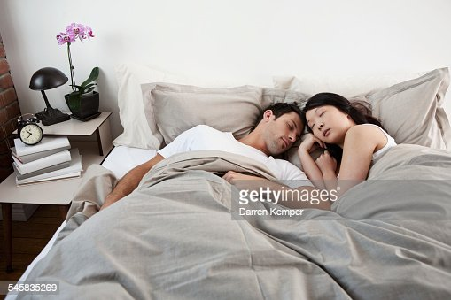 Young couple asleep : Stock Photo