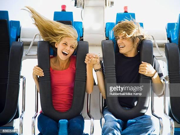 young couple at an amusement park