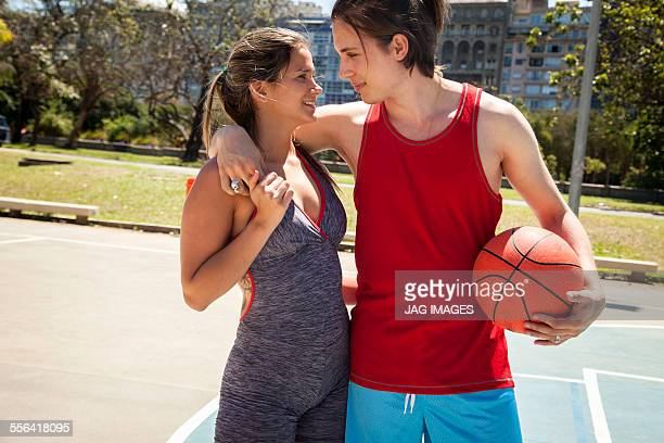 Young couple at basketball court
