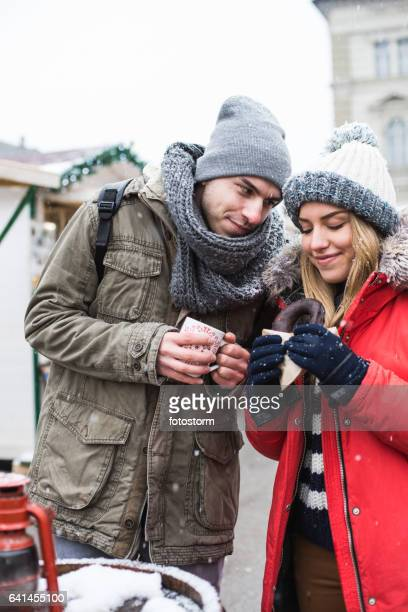 Young couple at Christmas market