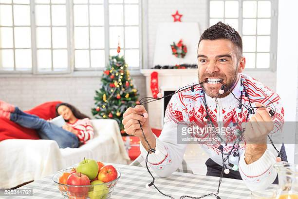 Young couple at home for Christmas