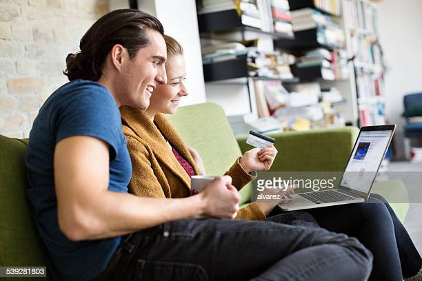 Young couple at home shopping online