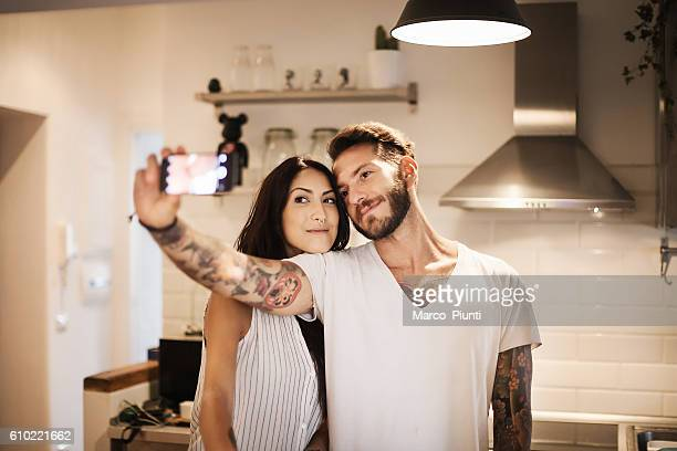 Young couple at new home - Selfie