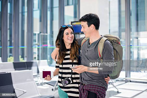 Young couple at the airport waiting