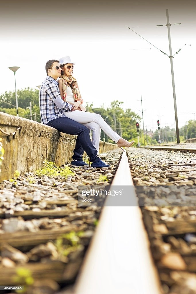 Young couple at the train station. : Stock Photo