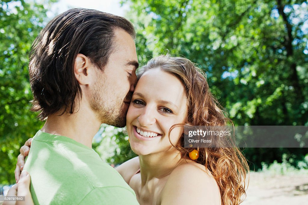 Young couple being affectionate : Stock Photo