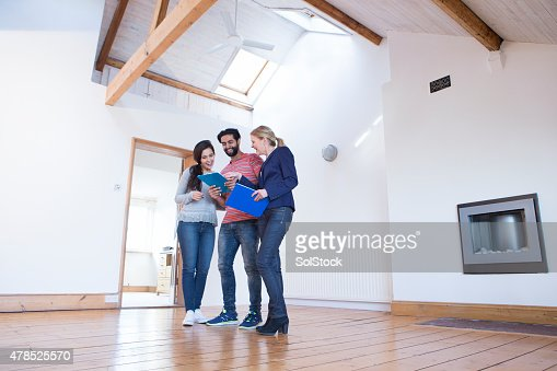 Young Couple Being Shown a New Home
