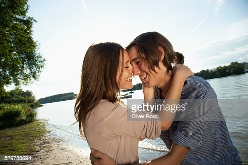 Young couple beside a lake : Stock Photo
