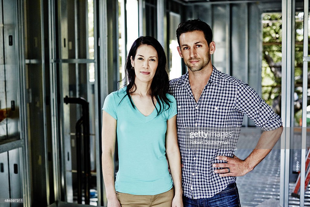A young couple building a new home. : Stock Photo