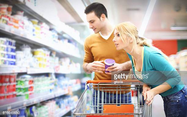 Young couple buying food in supermarket.