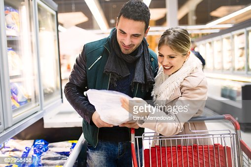 Young couple buying groceries in a supermarket