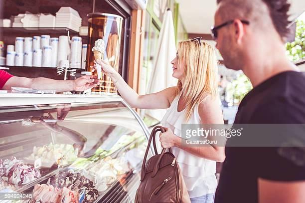 Young Couple Buying Ice Cream