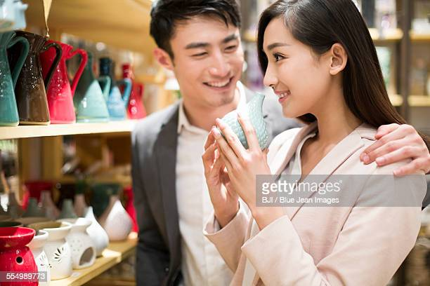 Young couple buying souvenirs in gift shop