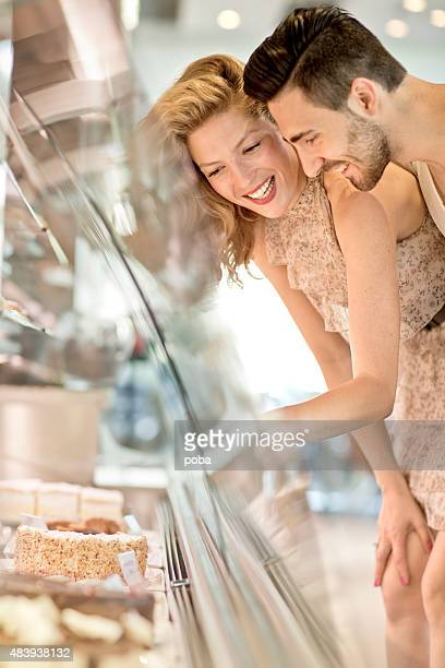 Young  couple buying sweets in pastry shop