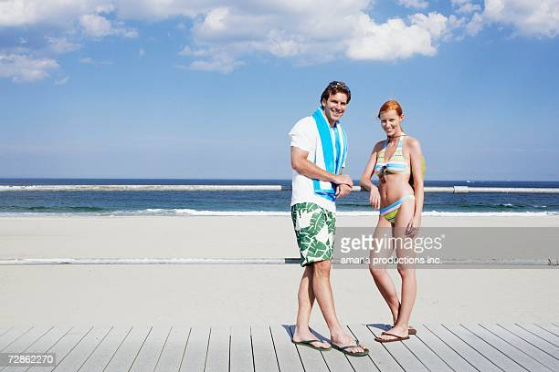 Young couple by railings at beach (portrait), Spring Lake, New Jersey, USA