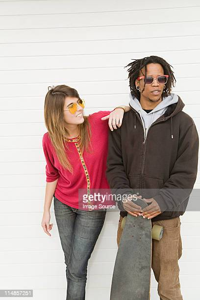 Young couple by wall