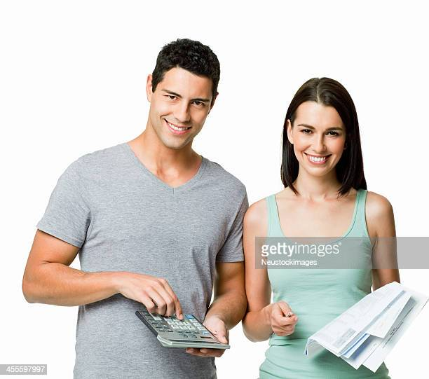 Young Couple Calculating Bills - Isolated