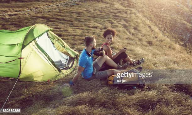 Young Couple Camping on Top of Hill