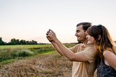 Young Couple Capturing Road Trip Moments