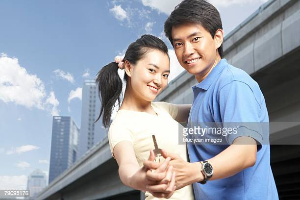 A young couple celebrates purchasing a new apartment.
