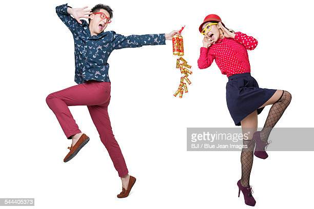 Young couple celebrating Chinese new year with petard