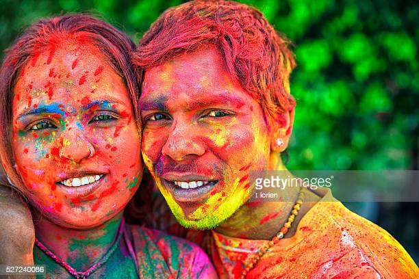 Young couple celebrating Holi togehter, India.