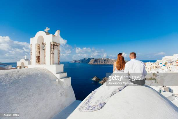 Young couple celebrating wedding at Santorini island, Cyclades, Greece
