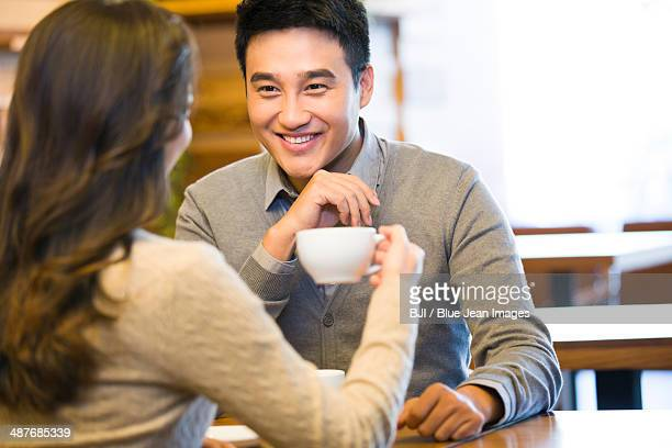 Young couple chatting in cafe
