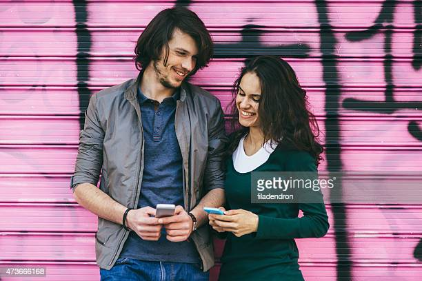 Young couple chatting on the phone