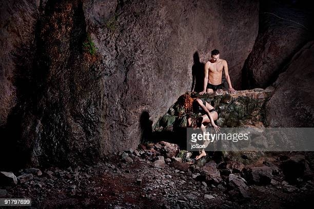 Young couple coming out of nature hot spring