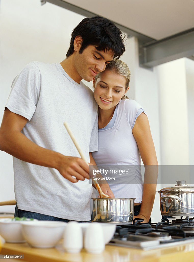 young couple cooking food in the kitchen : Stock Photo