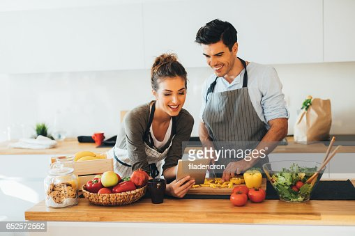 Young couple cooking in the kitchen : Stockfoto