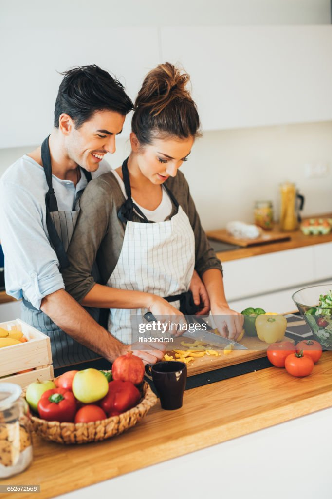 Young couple cooking in the kitchen : Stock-Foto