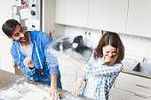 Young couple cooking together at home.