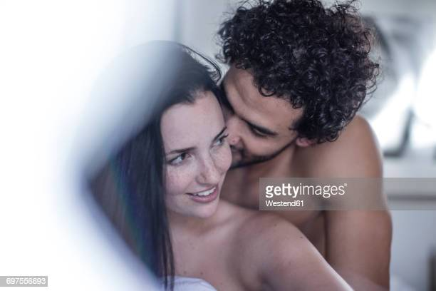 young couple nude cuddling images