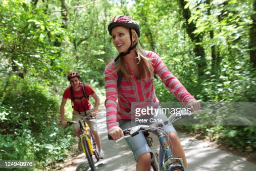 young couple cycling in country : Stock Photo