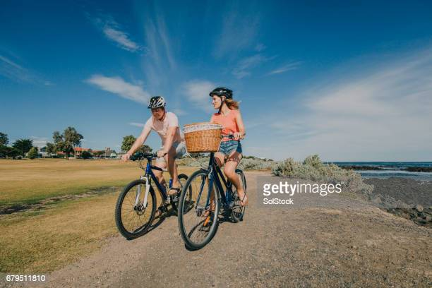Young Couple Cycling in the Park
