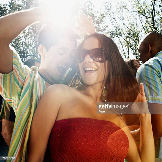 Young Couple Dancing at Outdoor Party