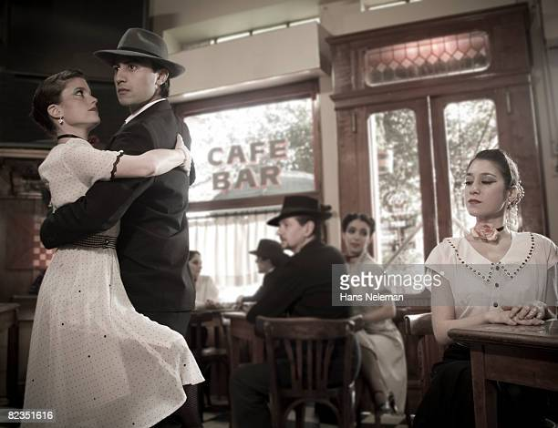 Young couple dancing in a cafe, Argentina