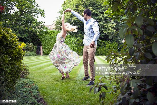 Young couple dancing in garden