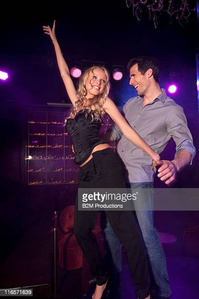 young couple dancing in nightclub