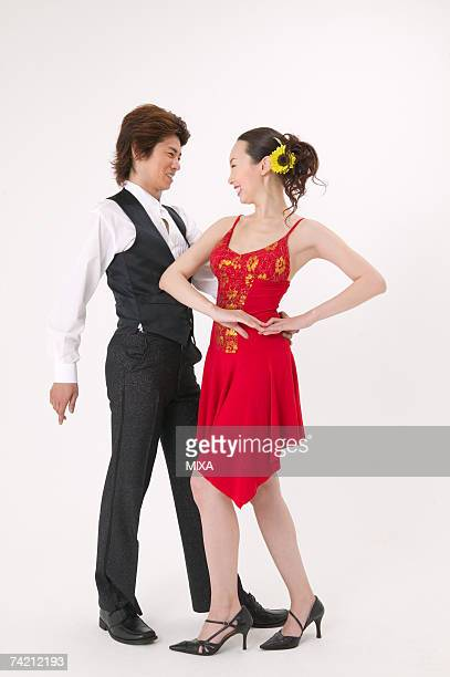 Young couple dancing salsa