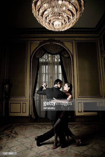 Young Couple Dancing Tango in Elegant Room