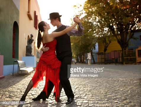 Young couple dancing Tango in street : Stock Photo