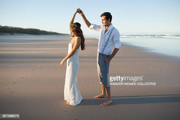 Young couple dancing wedding on beach