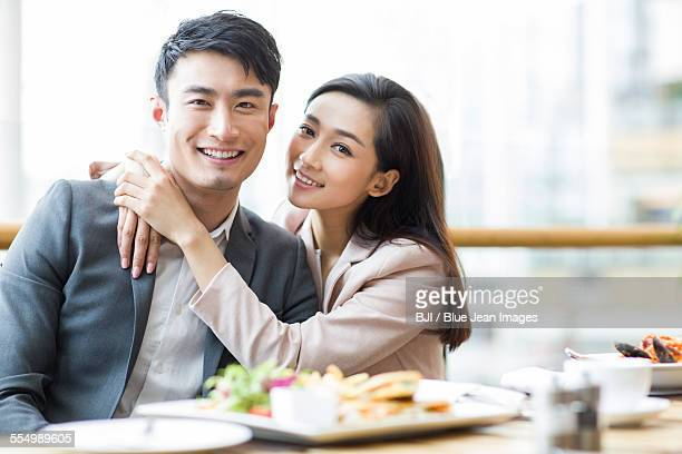 Young couple dining in restaurant