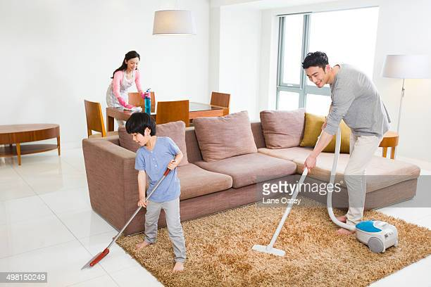 Young couple doing chores at home