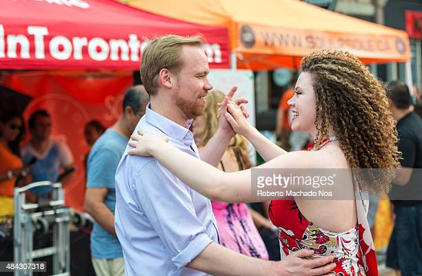 WEST TORONTO ONTARIO CANADA A young couple doing salsa dance at the Salsa on St Clair Avenue West Toronto It is a two day street festival celebrating...